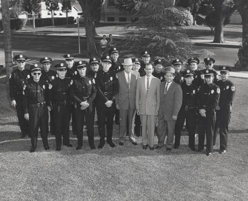 Corona Police Department 1959, Chief Joe Lowry and Officers. Front Row from left to right are Sgt. Jack Farnham, Ed Alvis, Lt. Les Phillips, Capt. Joe Greer, Chief Joe Lowry, Leon Kelly, Capt. Ben Briggs, Sgt. Robert Mosher, Robert Talbert, and Thomas Evans. Back Row from left to right are Lt. Richard Wade, Serafin Garcia, Gene Rogers, Sgt. Tony Espinosa, Kenneth Rycraft, Harry Blackford, Sgt. Abner Alton, Stanley Trnka, Marion Reed, Terry Taylor, and David Semple.