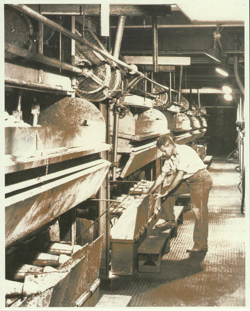 Man working with grinders at Exchange Lemon Products Plant.