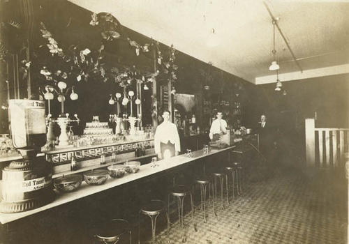 "Note with photo reads ""Interior of Perkins Confectionery.  Now Cunning Drug Store."" Actual timeline for building is Perkins Confectionery later to become Billings Drug, then Stanfield Drugs and then Cunning Drugs."
