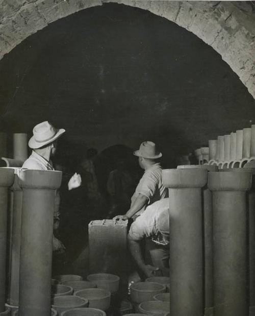Three men working on clay pipe.  The man on the right with the hat is Ramon.