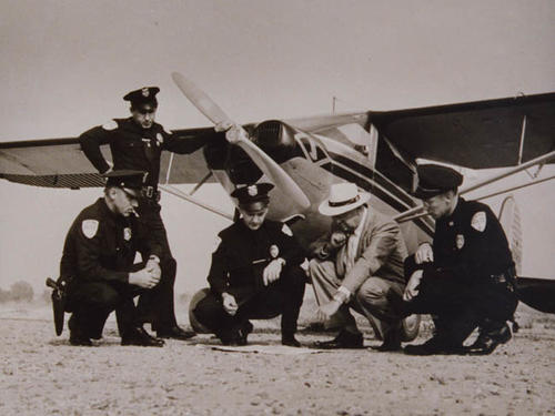 Mapping a mission, aero squadron. Left to right: Switzer, Compton, Farnham, Lowery, Greer.  Airplane is a Luscombe 8A.
