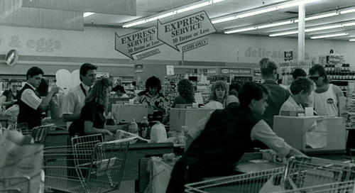 Workers and customers inside an Alpha beta Supermarket.