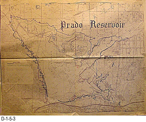 "The title of the topographical map is:  ""Prado Reservoid - Enlarged to Control Standard Project Flood - Estimated Maximum Water levels with Various Reservoir Flood Releases.  MAP ORIENTATION:  Top North - MEASUREMENTS:  47.25"" X 53"" - CONDITION:  Good (Several small tears that do not affect the readability of the map)  - COPIES:  1."