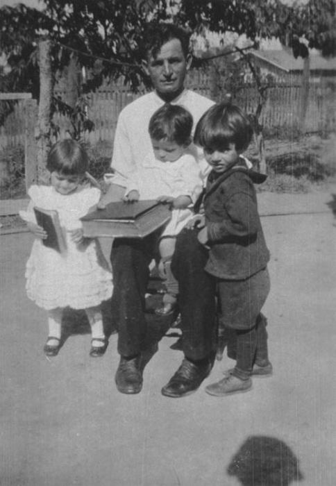 Father, Joseph Panattoni and lydia, David and Julio Panattoni in the backyard of house on northwest Grand Boulevard.