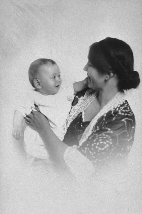 Photo of Shirley Willits and her son, Ned.  She is holding him in her arms.
