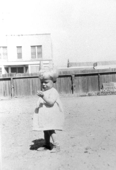 Melvin Knorr, young child, at 5th and Main.