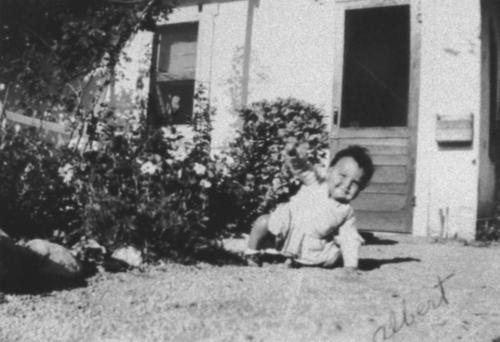 Baby, Albert Varela, two years old on the ground.
