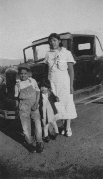 Lupe, John, and Margaret Zarate pictured with a car.