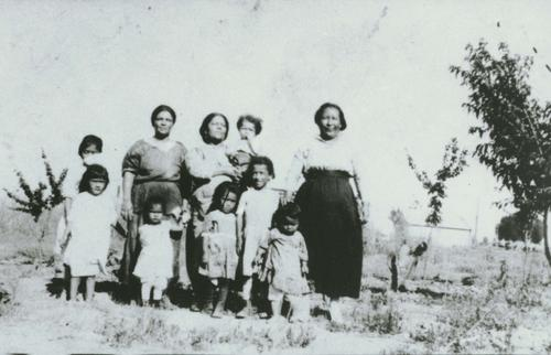 Second child from left: Maria (Lopez) Fernandez. Third child from left: Eleanor (Ponce) Riviera. Fourth child from left: Belen (Ponce) Rios. Back row, second person from left: Calletaria Lopez (family friend).