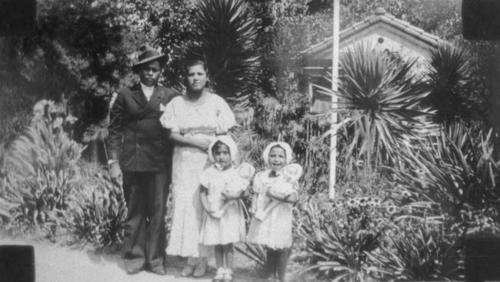 Man and woman with two children.  Ms. Lupe Rojo and Mr. Juan Rojo.  The names of the two children are unknown.