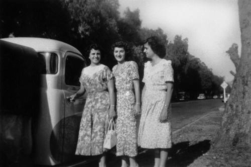 June, Lydia, and Ruth Panattoni standing in front of 1006 East Sixth Street. (now 756). Sixth street at beginning of widening. Pepper trees in process of being torn down.