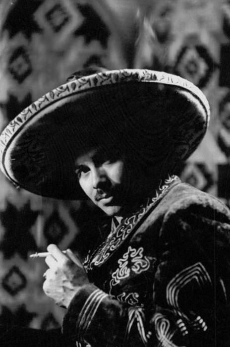Portrait of Rudolph (Rudy) Ramos with sombrero and a cigarette.