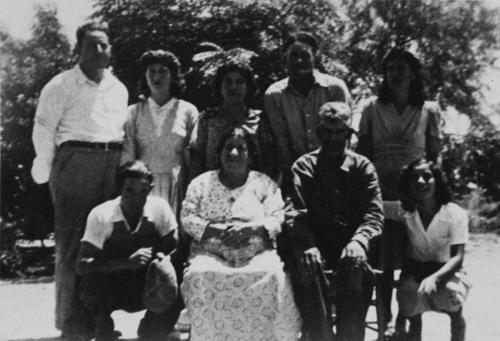 The Aguirre family lived in Corona at Violet Street. They worked for Mr. Brockman who made wells. Back row (left to right): Cruz Aguirre; Guera Aguirre; Trinidad Aguirre; Pedro Aguirre; Angela Aguirre. Front row (left to right): Domingo Aguirre; Delphina Aguirre; Fulgencio Aguirre; Refugio Aguirre.