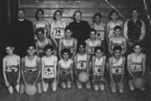 1949 St. Edward's basketball team photo. (back, left to right) unknown, unknown, Frank Granado, Father Thompson, Domingo Rodriguez, Mario Acevedo, Jerry DeGeorge. (middle, left to right) Frank Conriguez, Fred Montejano, Mitch Salgado, unknown. (front, left to right) unknown, unknown, Manuel Enriquez, Vico Ramirez, Alfonso Dominguez, John Maciel, Peter Maciel, unknown.