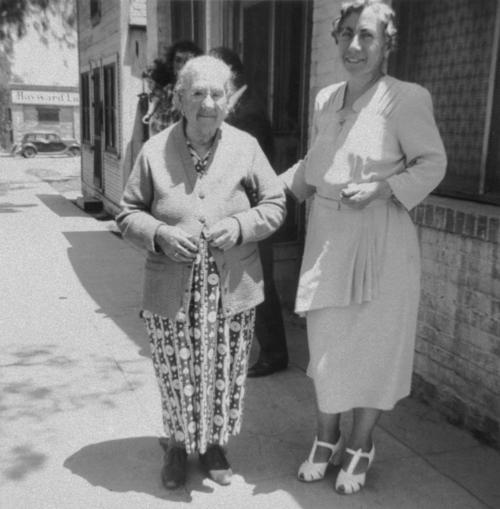 Antonia Lunetta with the minister's wife in front of the mission at 109 N. Main Street.