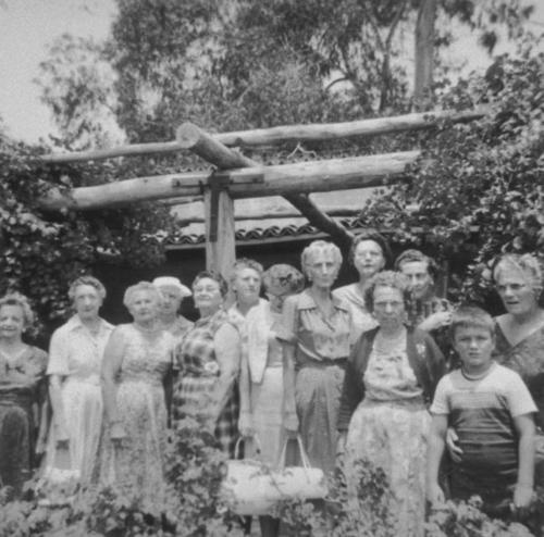 Pythian sisters at the Corona City Park picnic. Front Row: Ida Zumstein, Alma Parr, Ethel Thomas, Grace Vecella, Isabelle Francisco. Ida Bays, grandson (?) Donny; Back Row: Marie Brenderson, Ruth Watson, Alice Reeves, Nellie Tucker, Mable Bays.