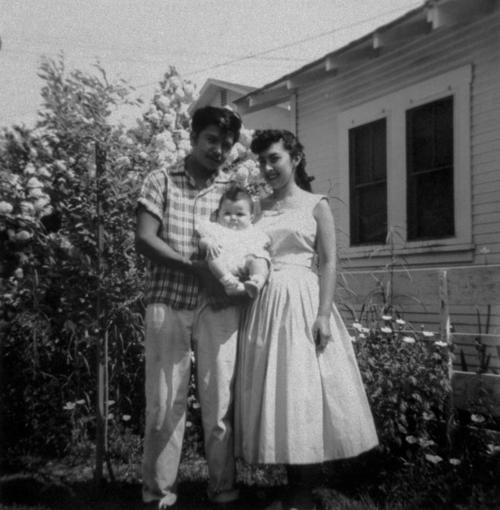 Esther and Daniel Munoz and Baby Carmen Munoz. Photo taken in front of mom's home at corner of Merrill and Ninth (9th) Streets.