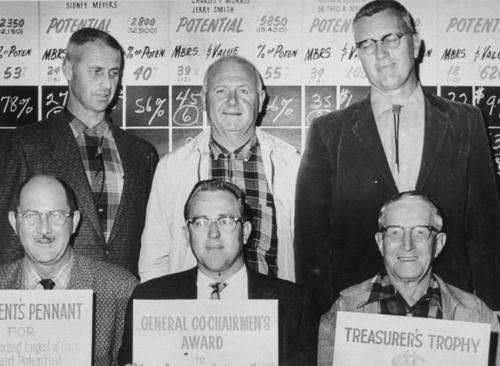 "Chamber of Commerce group picture. Part of membership campaign during Terry Ware's presidency. Front: Harry Cole, unknown, A.K. Whidden. Back: Terry Ware, Herb Garton, ""Dutch"" Velthoen."