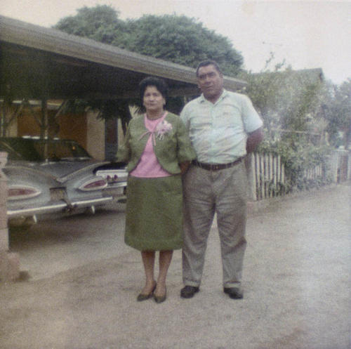 Josephina and Aniceto Hernandez in alley by their home.