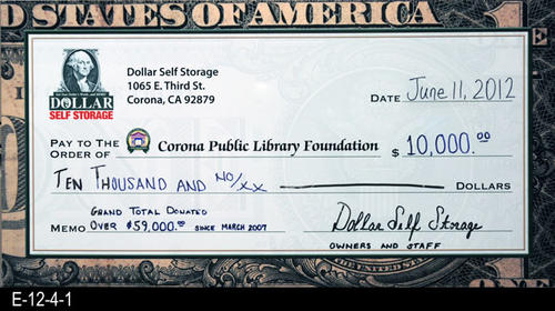 This poster is a facsmilie check for ten thousand dollars given to the Corona Public Library from electronics recycling.  Since March 2007, Dollar Self Storage has donated over $49,000.
