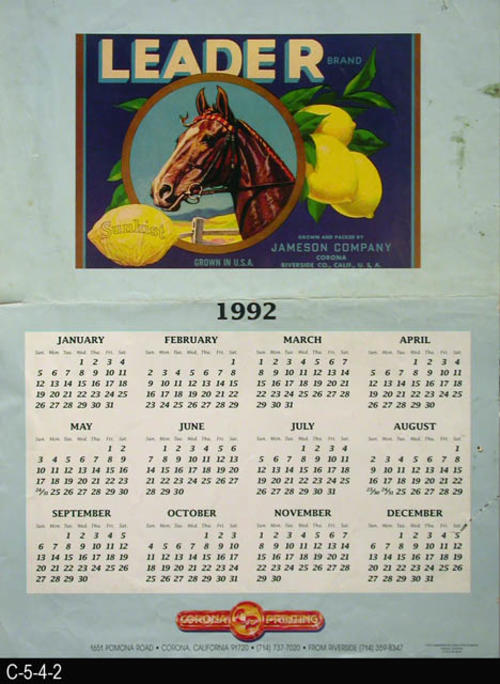 "This poster is a 1992 calendar on a light blue background featuring a Leader Brand fruit label picture.  The color separation work was done by  Inland Color Graphics of Corona, CA.  MEASUREMENTS:  24"" X 18"" - CONDITION:  This poster has a horizontal crease in the middle and a dark stain in the upper right area.  There is a two inch tear in the lower right margin area  - COPIES: 1."
