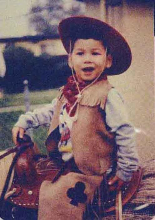 Young boy in cowboy outfit on horse. Irene Navarro family photo.
