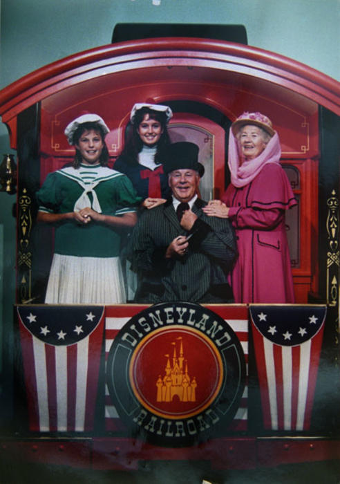 Julie and Jennifer Farrell with grandparents (from Florida) in Victorian wear. Photo taken at Disneyland.