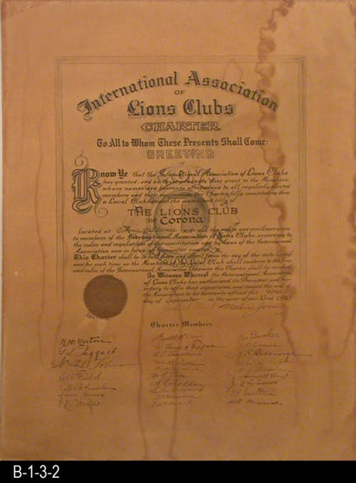 "This document is the original Charter for the Lions Club of Corona, given by the International Association of Lions Clubs. (This document was formerly ARTIFACT:  AAA.0396.) - MEASUREMENTS:  22"" x 17"" - CONDITION:  The paper on this document is turning brown and has extensive staining.  It is kept in a protective Mylar sleeve. - COPIES:  1 Original and 1 Photocopy."