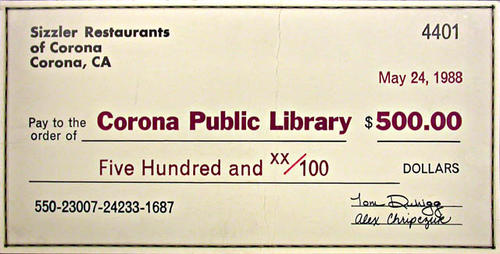 "This document is a facsimile of a $500 check from the Sizzler Restaurant of Corona, California.  It was used during the library expansion program. - MEASUREMENTS:  9"" x 18"" - CONDITION: Good. - COPIES:  1."
