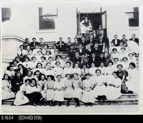 "This is a BW photograph of the first Corona Senior High School, with students from the Class of 1912 in front of school building.  The names of students appear on the back of the photograph. - MEASUREMENTS:  11 1/4"" X 13 7/8"" - CONDITION:  This photograph is in good condition.  A tear in the lower right and corner has been taped on the back side. It is kept in a Mylar sleeve. - COPIES:  1"