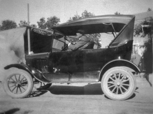 Victoriano Zarate, Amelia Lerma's grandfather, in a car.  Photo taken on Chase Drive Ranch in Corona.