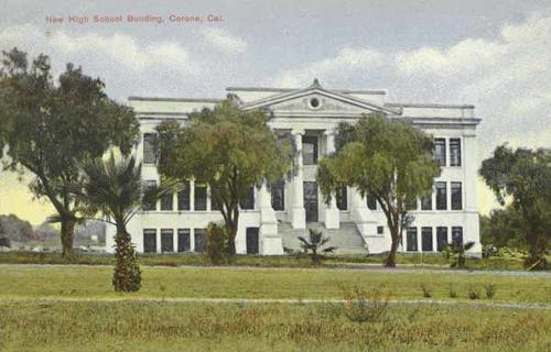 A color postcard of a new high school labeled New High School Building, Corona, California.