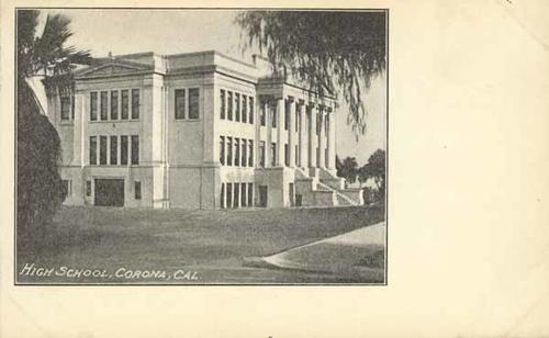 A black and white postcard of a high school labeled High School, Corona, Cal.