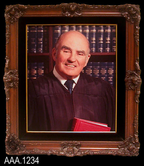 "This artifact is a framed color photograph of the Hon. David N. Strausser.  He served as a judge of the Corona Municipal Court from 1961-1968. It hung on the wall of the Corona Courthouse were he served as judge.  This framed work measures 27 1/4"" x 23"" x 3 1/4""."
