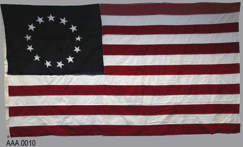 This artifact is a Betsy Ross design first delivered to General Washington in 1783. It measures 8' x 5' and is a newly manufactured flag, not historical.  CONDITION:  New