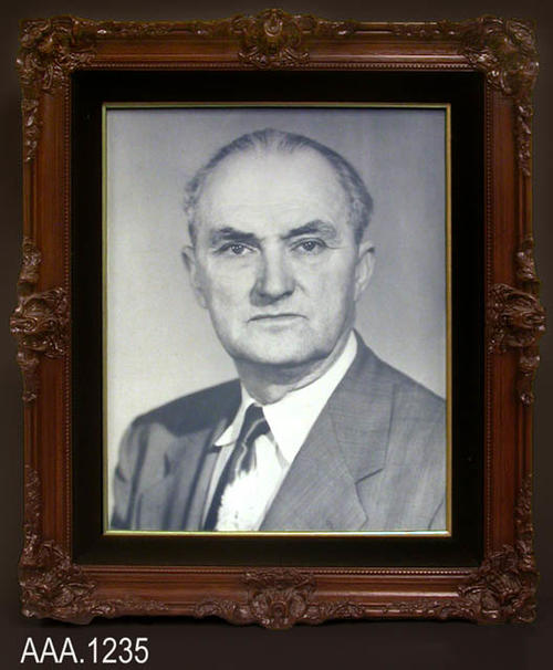 "This artifact is a framed B/W photograph of the Hon. Willy S. Caudill. It hung on the wall of the Corona Courthouse were he served as judge.  This framed work measures 27 1/4"" x 23"" x 3 1/4""."