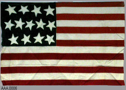 "This artifact is a thirteen Star (NOT a Betsy Ross) American flag and measures 33 1/4"" x 22"" - CONDITION: Fair"