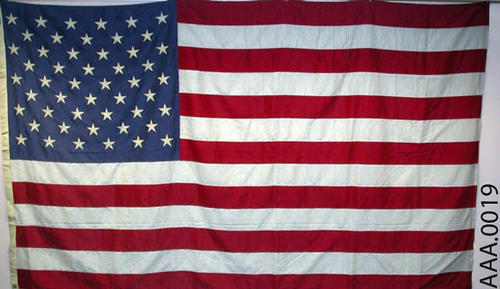 This artifact is a fifty-star, American flag.  CONDITION:  This condition of this flag is excellent.