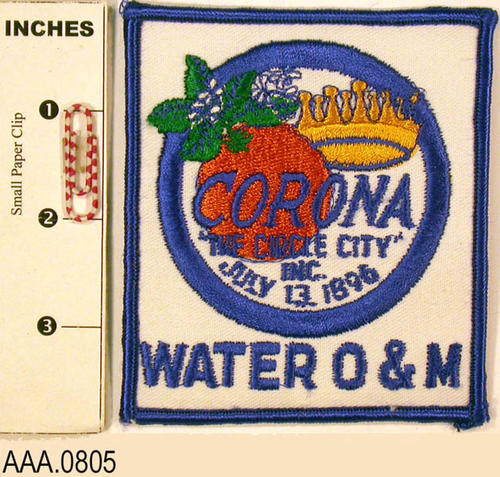 "This artifact is a colored patch with the City logo and text which reads, ""Water O and M."""
