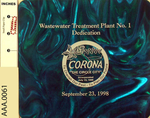 "This artifact is a dark turquoise computer mouse pad has a plastic top and a rubber bottom.  The top of the mouse pad is imprinted as follows:  ""Wastewater Treatment Plant No. 1 Dedication."" Below this is the logo for the City of Corona, and below the logo is the dedication date:  ""September 23, 1998."""