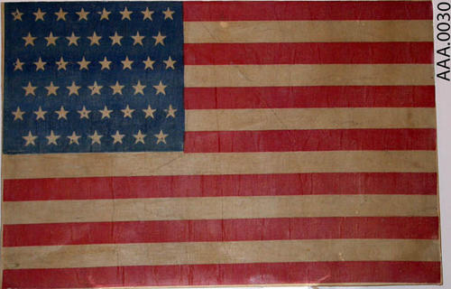 This artifact is a forty-five star, American Flag it is mounted on a plastic board.  Utah was the forty-fifth state to join the Union on January 4, 1896.