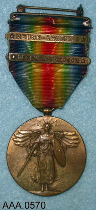 "This artifact is a World War I medal with a multi-colored ribbon with two bars:  ""Meuse - Argonne"" and ""Defense Sector.""  The back of the medal has the following text:  "" The Great War For Civilization.""  Also the countries who fought the axis are also listed. Donor's Remarks:  This artifact was owned by Jenny Adamo and belonged to Grover C. Rutledge."