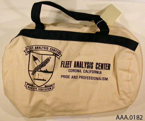 This artifact is a round sports bag; Fleet Analysis Center souvenir.