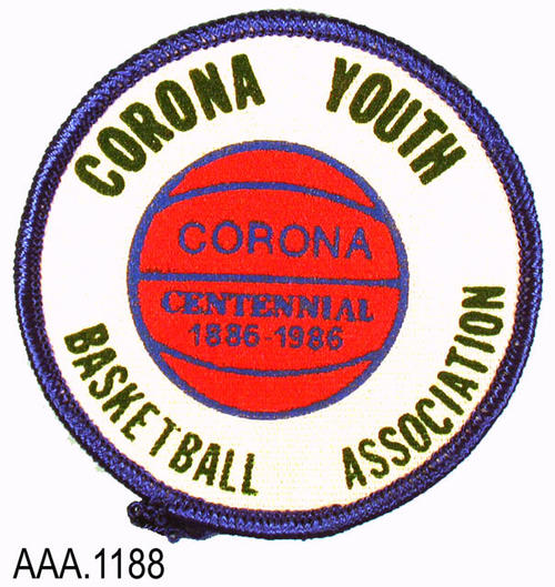 "This artifact collection consists of five identical uniform patches.  The text in the outer circle reads: ""Corona Youth - Basketball Association.""  The text on the inner circle reads: "" Corona - Centennial - 1886-1986""  This patch is 3"" in diameter."