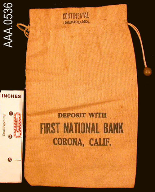 "This artifact is a deposit money bag.  On the top portion of the bag it says, ""Continential, Mexico, MO.""  On the body of the bag is the following text:  ""Deposit with First National Bank, Corona, CA."""