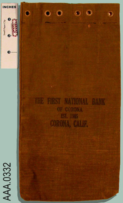 "This artifact is an olive green money bag imprinted with the following text:  ""The First National Bank of Corona - Est. 1905. - Corona, Calif."""