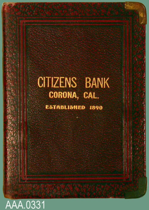"This artifact is a savings bank with the following text:  ""Citizens Bank - Corona, CA.).  (See donors note attached to donor form on 1-23-97)"