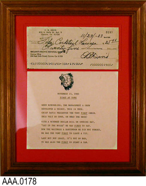 "This artifact is a plaque on which is mounted a check and poem.  The check is from C. B. Davis to the Tops Cocktail Loung.  The peom below the check is entitled:  ""First At Tops."""