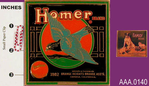 "This artifact collection consists of two items. The first artifact in the group is a pewter tile with the ""Homer Brand"" citrus label with a cloth cover and box.  The second artifact is a plastic magnet with the ""Family Brand"" citrus label."