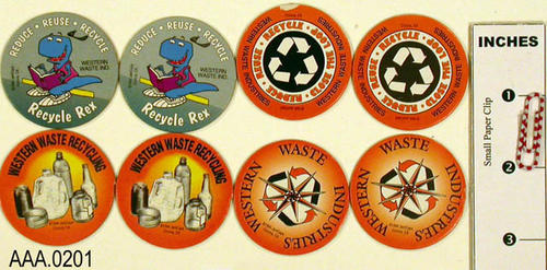 This artifact collection consists of eight pogs with various fruit logos on them.  They are from Western Waste and encourage recycling.